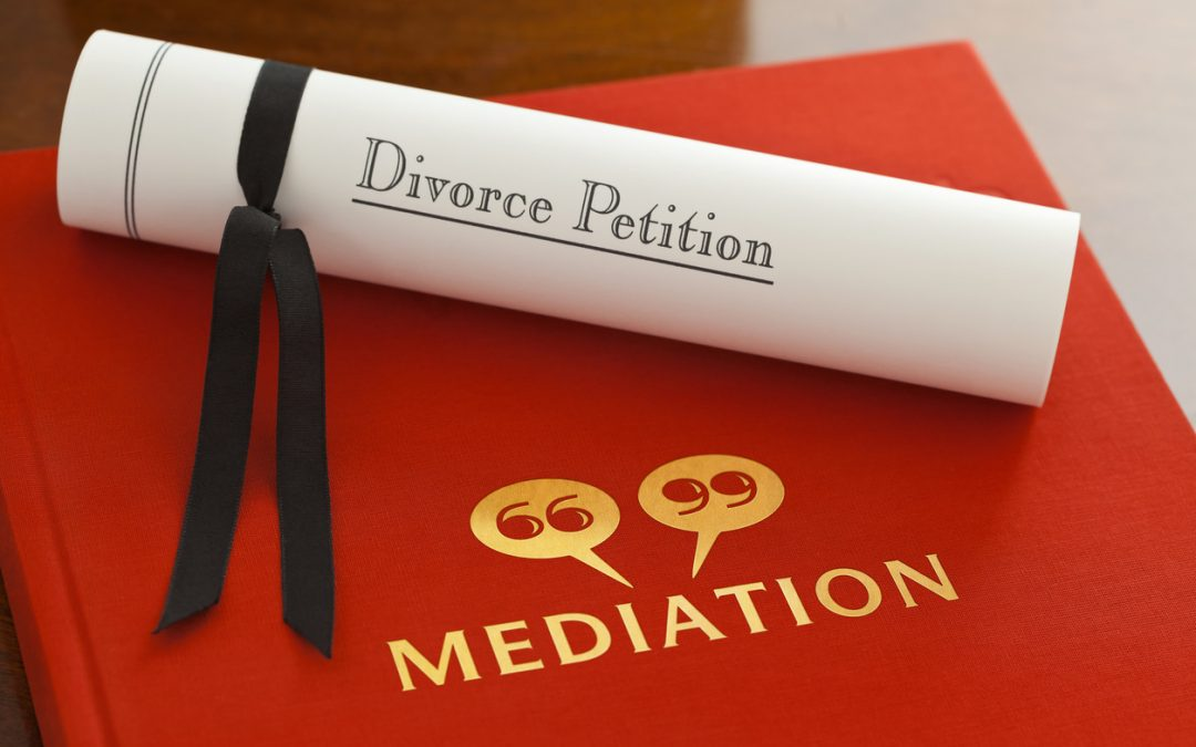 What should a divorcing couple know about the process of using a divorce mediator and what are the benefits?